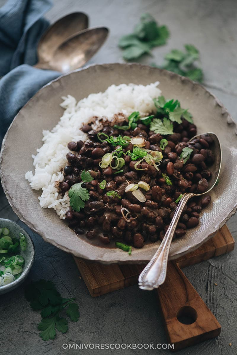 Black beans with rice garnished with cilantro and green onions