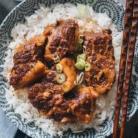 Braised beef brisket on top of rice