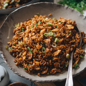 Soy Sauce Fried Rice (酱油炒饭) | Simple yet indulgent, it's a classic Chinese takeout dish that uses minimal ingredients to create maximum flavor. Only takes ten minutes to prepare, and it's robust enough to serve as a main or to satisfy your midnight salty snack craving.