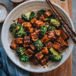 Chinese tofu and broccoli served with rice