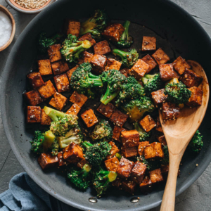 Tofu and Broccoli Stir Fry | Make this easy tofu and broccoli for a healthy and delicious meal in 30 minutes! The tofu is cooked until perfectly browned and flavorful, then cooked with tender broccoli in a sticky ginger garlic sauce. {Vegan, Gluten-Free Adaptable}