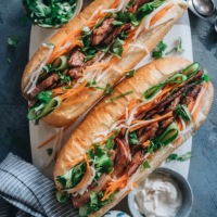 Turn your leftover Easter ham into a Vietnamese favorite with this fast, flavorful ham banh mi sandwich you'll want for lunch every day! A quick pickle recipe is included so you can recreate that authentic taste in your own kitchen.