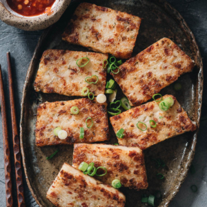 Chinese Turnip Cake (lo bak go, 萝卜糕) - Learn how to make extra tender and flavorful Chinese turnip cakes that are loaded with goodies. They taste way better than the restaurant version. This dim sum classic is a must-have for Chinese New Year and a great appetizer for any Chinese dinner party.