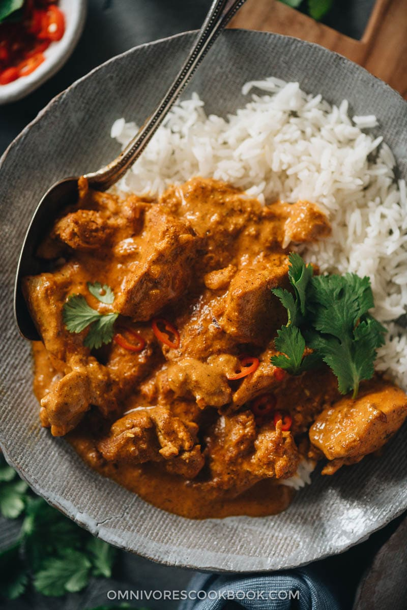 Butter chicken served over rice close-up
