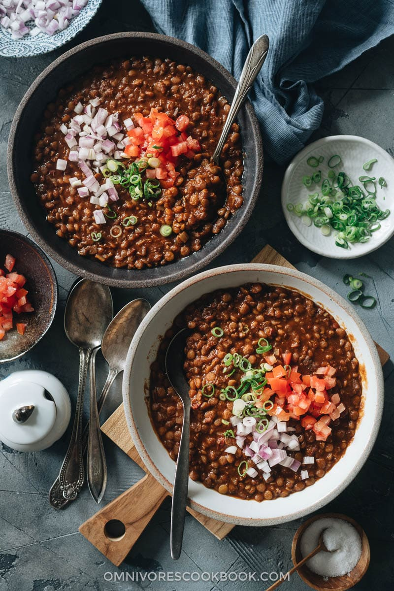 Lentil soup topped with chopped tomato and onion