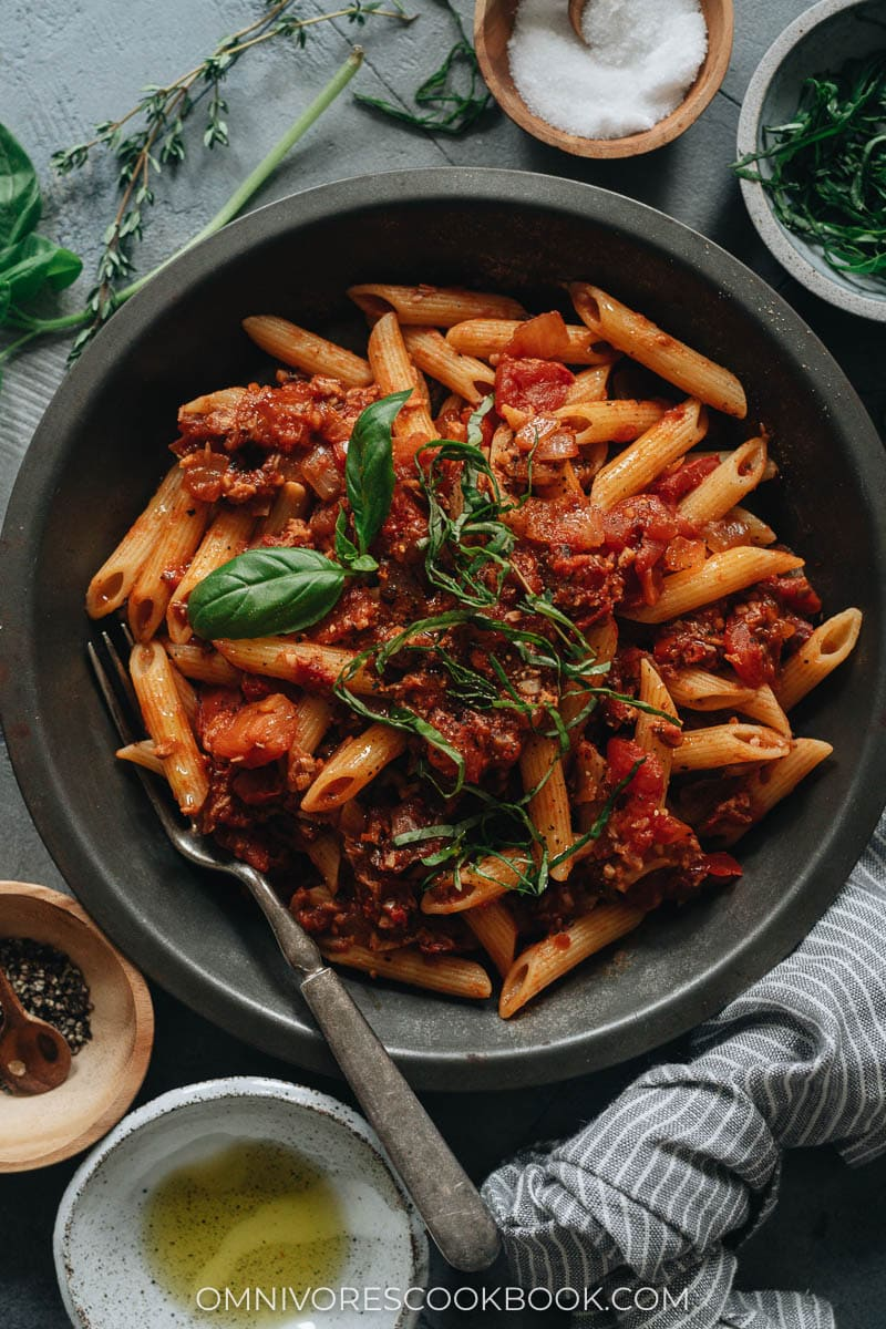 Arrabiata pasta topped with basil