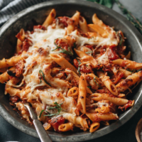 This savory Arrabiata pasta uses pantry staples to give a classic Italian dish a hint of Asian fusion. One pot is all you need for a rich, saucy dinner experience that can easily be tailored to a vegan lifestyle! {Vegetarian, Vegan-Adaptable}
