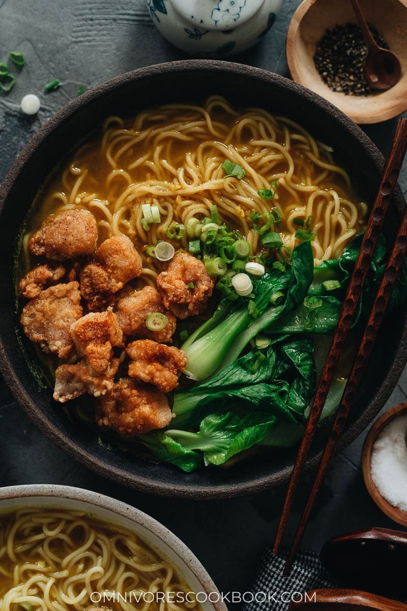 Chinese noodle soup topped with crispy chicken and baby bok choy