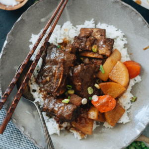 This Instant Pot short ribs recipe helps you create authentic Korean flavors with fork-tender braised beef swimming in a savory yet sweet and fruity sauce. It's perfect for any night of the week! I also included a bonus recipe teaching you how to use the leftovers to make 10-minute noodle soup. {Gluten-Free Adaptable}