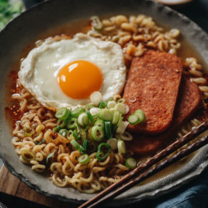 Turn a few simple pantry staples into a satisfyingly delicious Spam ramen meal in minutes. Hearty and filling, you won't believe that a package of ramen noodles can become a gourmet experience!