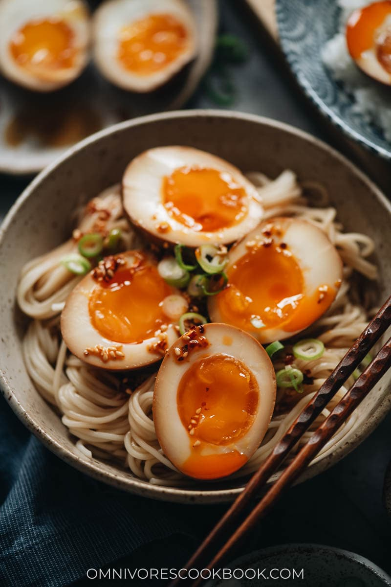 Marinated eggs on noodles with chili oil