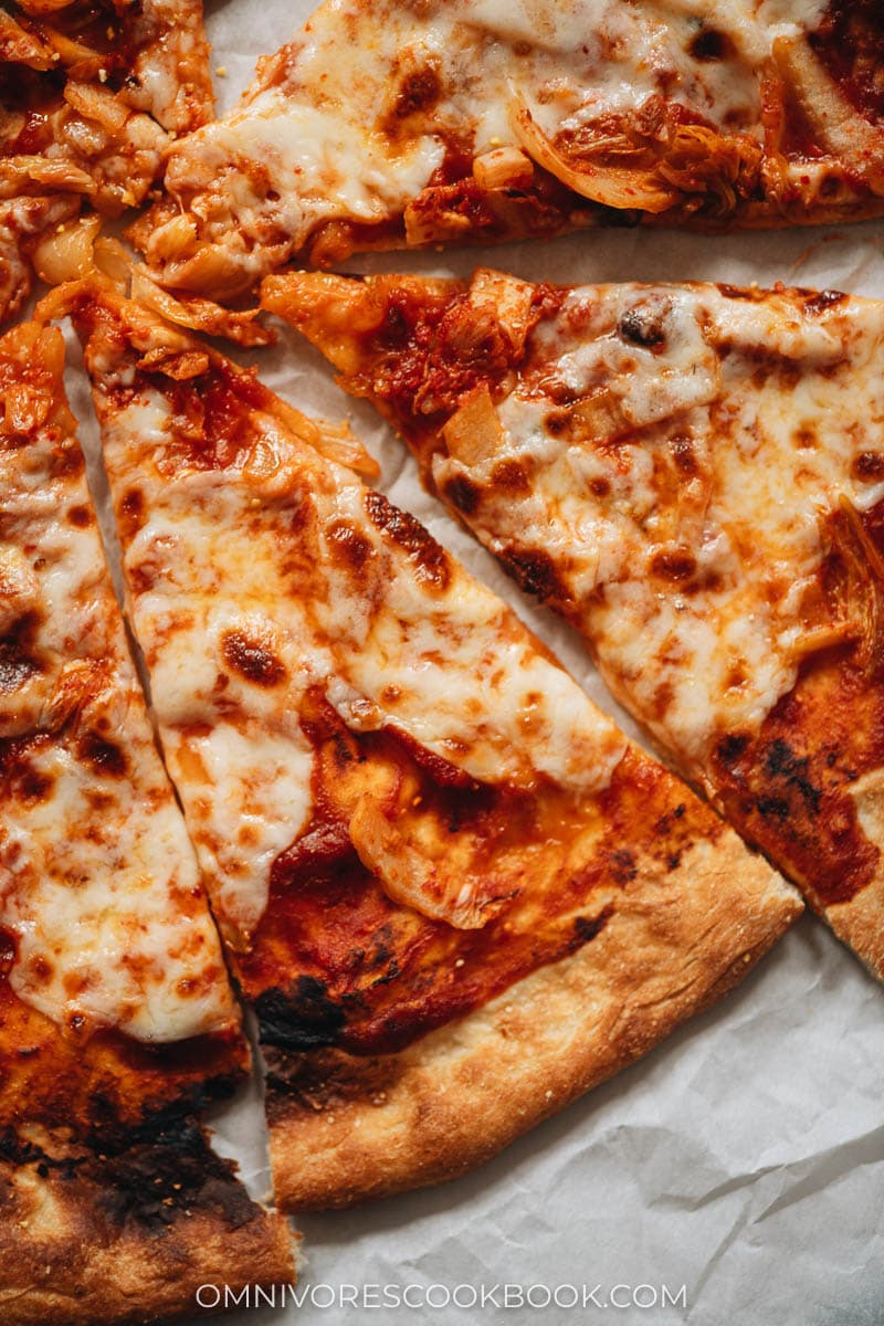 Pizza with hot sauce and mozzarella close-up