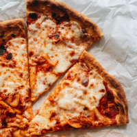 My homemade easy kimchi pizza recipe takes your favorite comfort food to a whole new level with a rich and spicy sauce you'll crave! {Vegetarian}