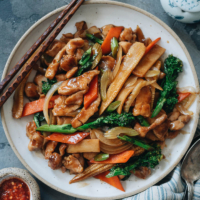 Tender juicy chicken bites with crunchy veggies in a rich sauce for a classic Chinese takeout-style chicken chop suey no one can resist! It's a perfect recipe to use up your leftover vegetables. My blog post includes detailed instructions on how to assemble your own chicken chop suey using different veggies. {Gluten-Free Adaptable}
