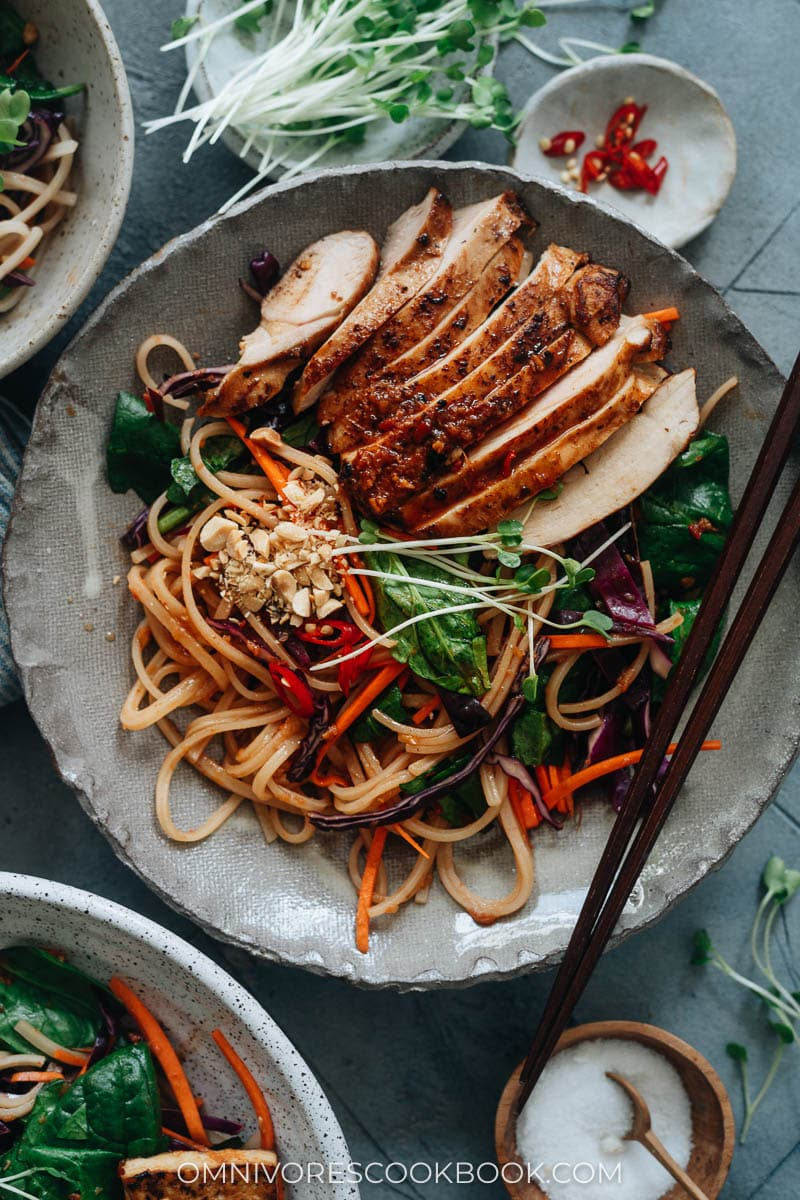 Spicy rice noodle salad topped with chicken