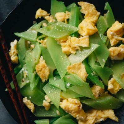 Celtuce stir fry with eggs close-up