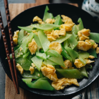 Delicate and delicious celtuce stir fry with eggs is an authentic Chinese homestyle dish that gives you a unique balance of texture and taste that you won't want to miss! {Gluten-Free, Vegetarian}