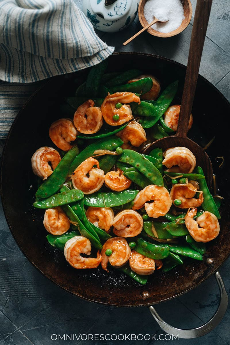 Stir fried shrimp with snow peas in a skillet