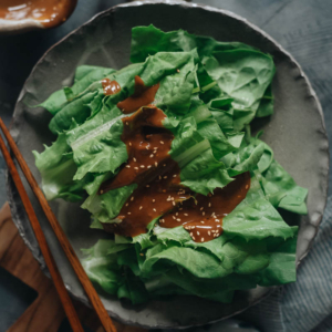 This refreshing and delicious appetizer, celtuce leaves salad, features a rich sesame sauce that will have you happily eating your veggies! {Vegan, Gluten-Free adaptable}
