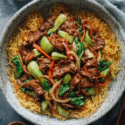 Hong Kong style beef and brown sauce over crispy noodles