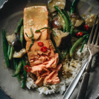 Salmon with green curry over rice