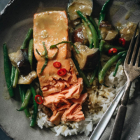 Delicious and balanced, this salmon curry features crispy skin and plenty of veggies in a creamy green coconut curry inspired by Thai cuisine. {Gluten-Free}
