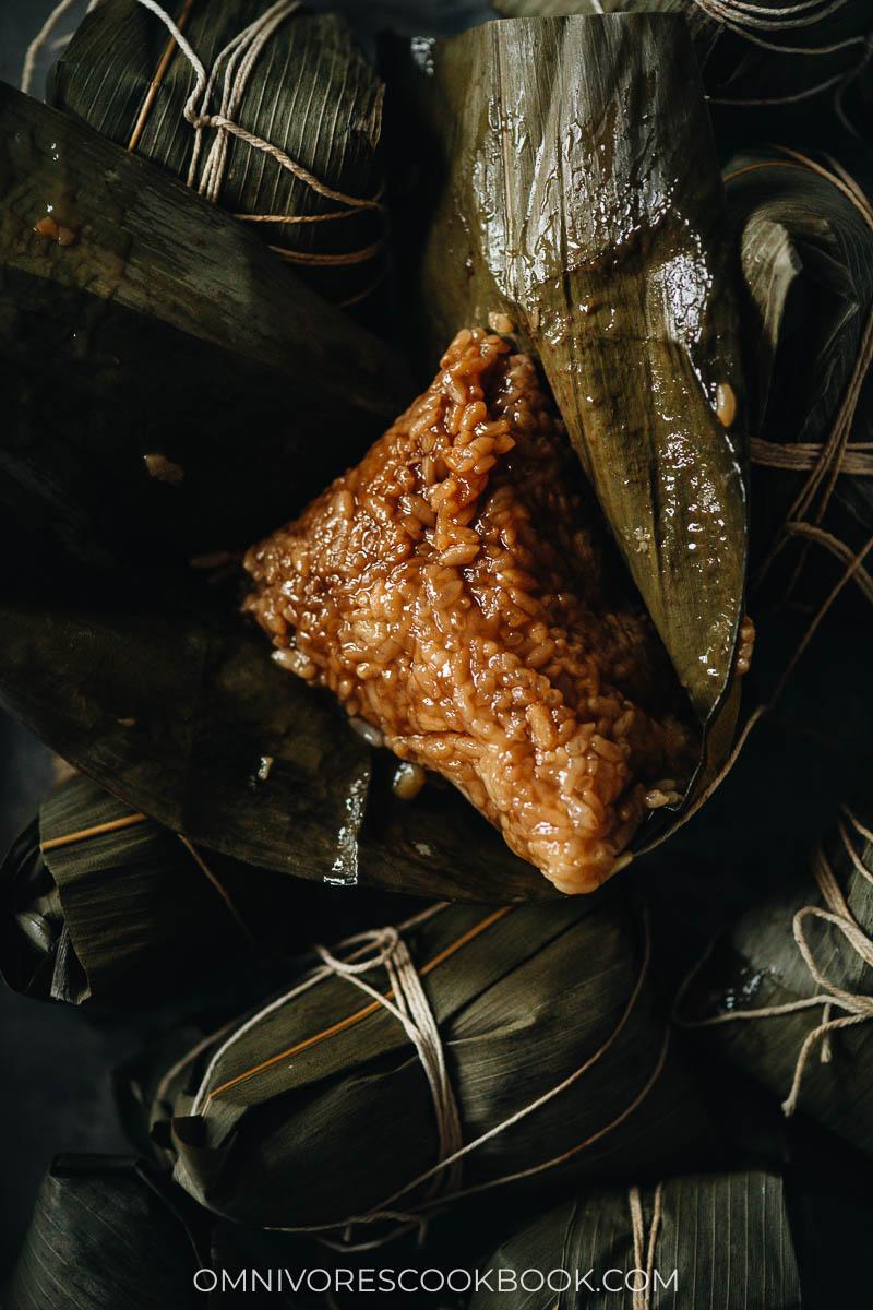 Pork zongzi on bamboo leaves