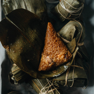 Savory zongzi on bamboo leaves