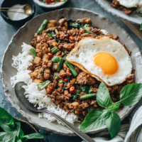 Pad krapow gai with green beans and sunny egg