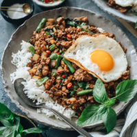 The fastest way to get great tasting Thai food is to make it in your own kitchen with this aromatic, flavorful and healthy Thai basil chicken recipe. {Gluten-Free Adaptable}