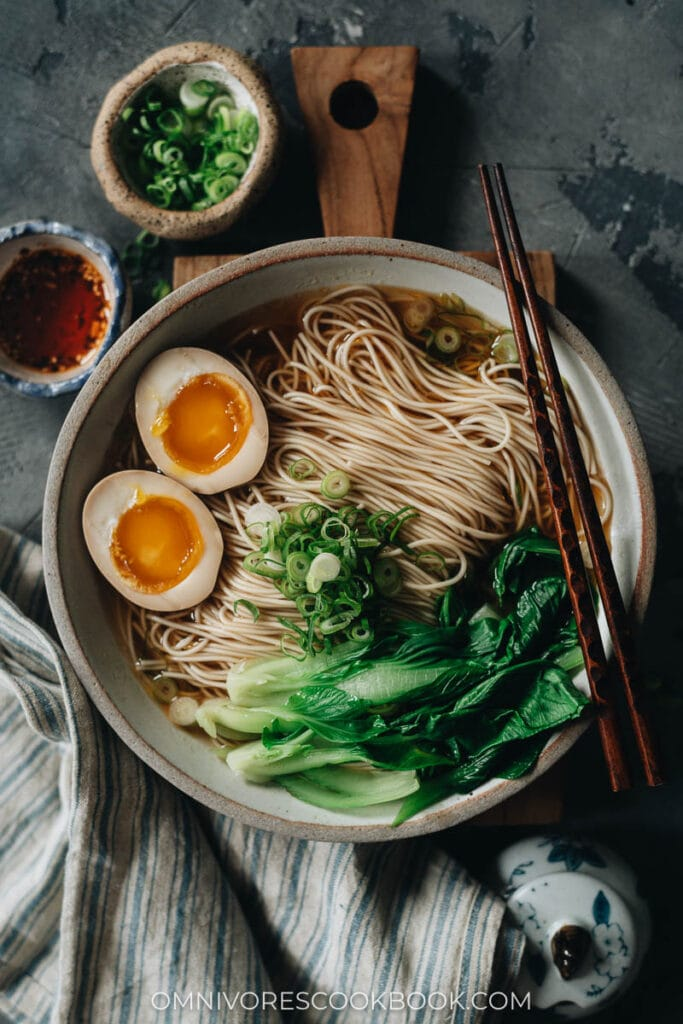 Soy sauce noodles topped with bok choy and egg