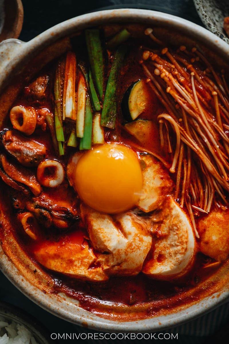 Korean soft tofu stew with seafood close up
