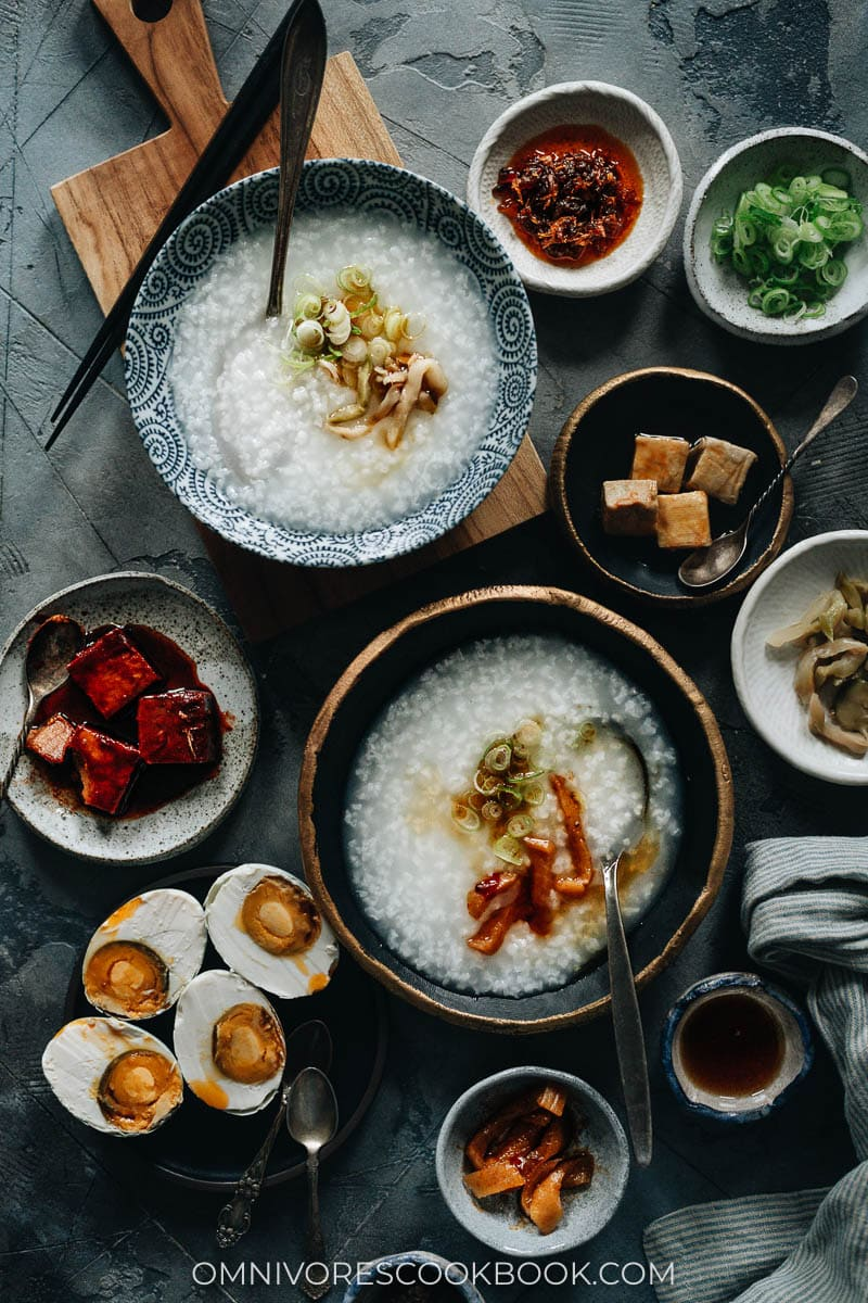 Plain congee topped with pickles, sesame oil and green onion