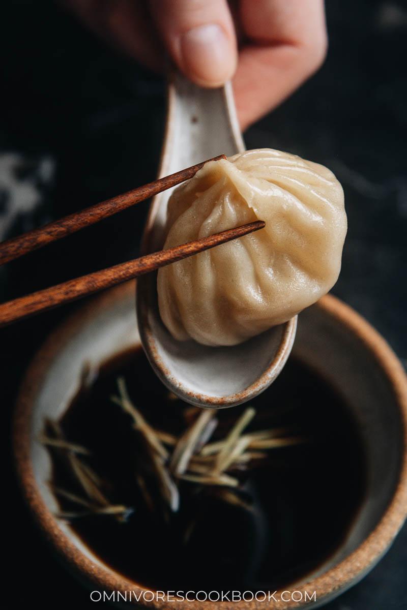 Holding Xiao Long Bao with chopsticks