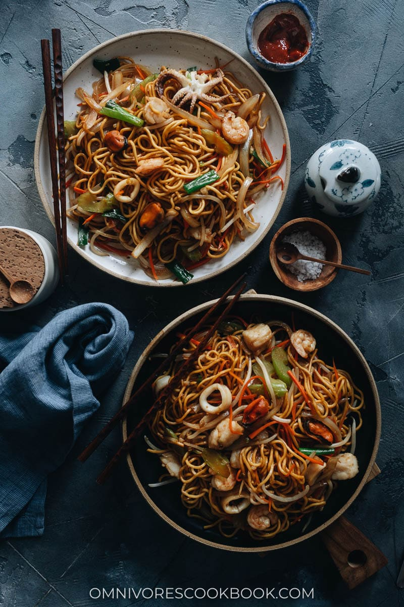 Seafood chow mein served on plates