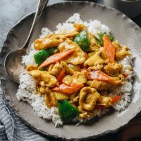 Bring takeout taste home by making Chinese curry chicken in your kitchen. It's brimming with tender chicken and crispy veggies in a cheerful bright yellow curry sauce. {Gluten-Free Adaptable}