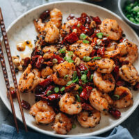 Stir fried shrimp accented with bright pop of Sichuan flavor: chile pepper, tingly peppercorn, and a dose of umami will just dazzle your taste buds.