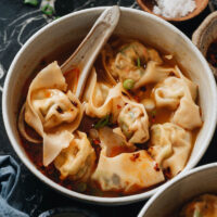 Vegan Wonton Soup is a restaurant-quality treat that celebrates the bright flavors and diverse textures of a number of different veggies. The homemade broth is rich with umami and deeply comforting. The wontons and soup combine for a bowl of hot nourishment that is hard to beat.