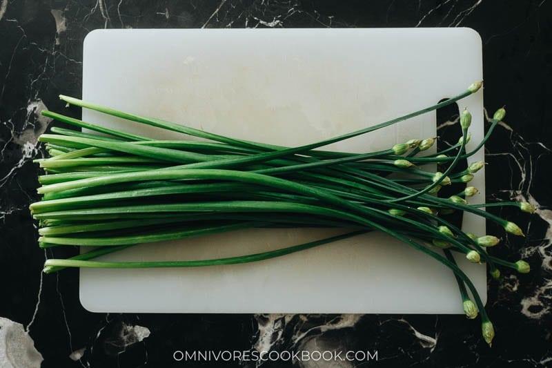 Fresh garlic chives on a cutting board