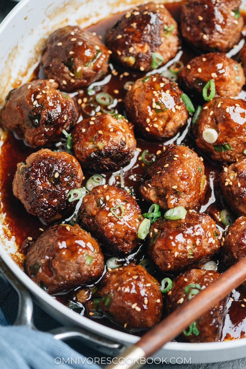 Close-up of brown meatballs in a white skillet