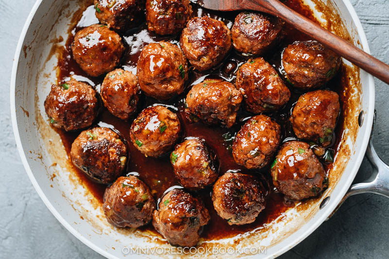 Sticky, juicy meatballs in a skillet