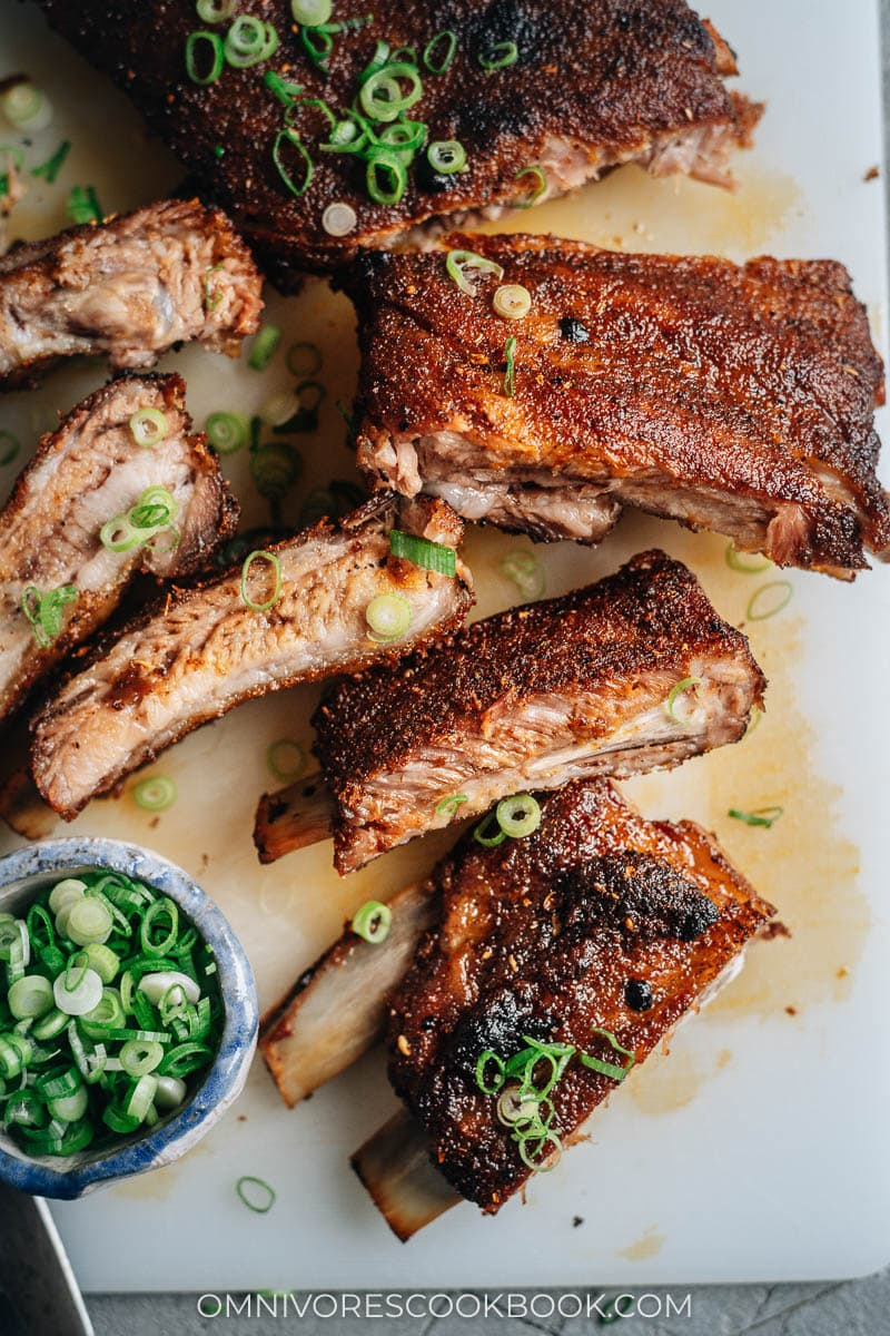 Juicy, spicy Chinese style pork ribs with sliced green onion