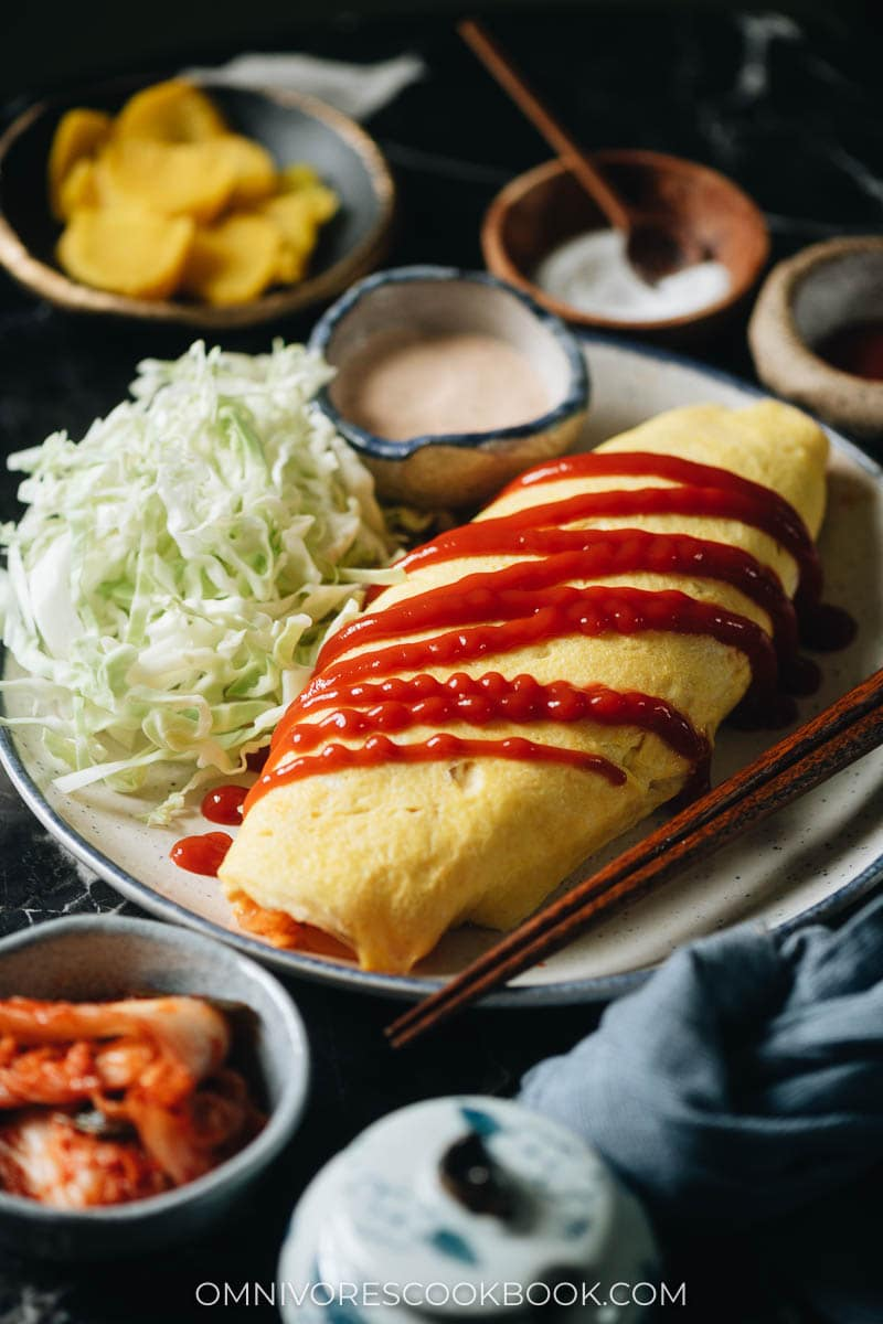 Omelet stuffed with kimchi fried rice on a plate