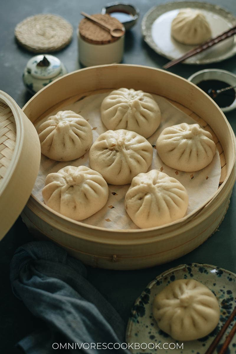 A bamboo steamer with Chinese steamed buns