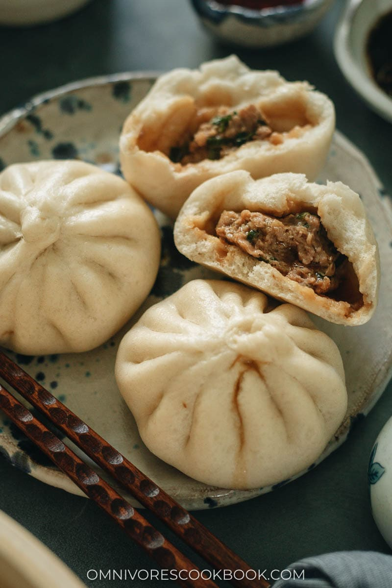 Fluffy steamed buns filled with juicy pork and Chinese chive