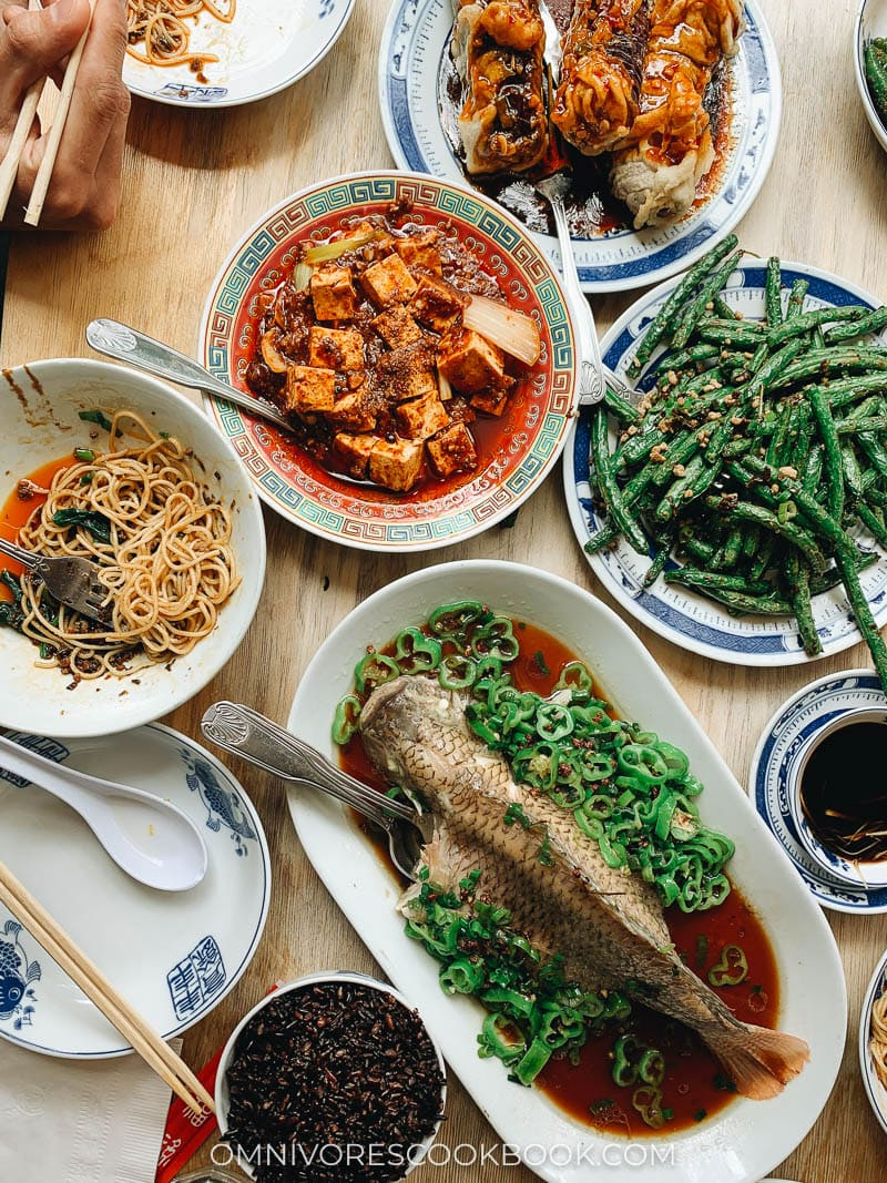 A Sichuan Chinese dinner spread with whole fish, mapo tofu, green beans, and eggplant at Birds of a Feather