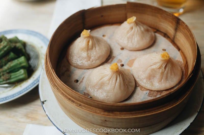 Shanghai-style soup dumplings in a bamboo steamer