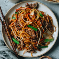 Tender slices of beef mingling with thick lo mein noodles, vegetables, and a savory sauce are perfect for tonight's dinner in this beef lo mein. And it takes less time than takeout to put on your table!