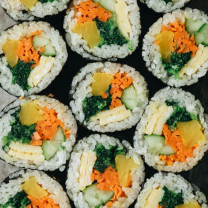 Vegetarian Kimbap is a Korean classic featuring egg, rice, and veggies rolled in seaweed. It's both refreshing and satisfying and perfect for an appetizer, snack, or picnic. {Gluten-Free, Vegan-Adaptable}