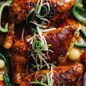 Asian style roast chicken legs and thighs with green onion